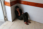 A relative of Palestinian teenager Belal Khafaja, who was killed by Israeli forces during clashes in tents protest at the Israel-Gaza border, mourns at a hospital in Rafah in the southern Gaza Strip on September 7, 2018. Photo by Ashraf Amra