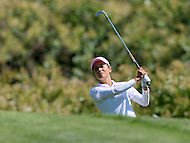 Owings Mills, MD - July 26, 2014: Ai Miyazato, of Team Japan, plays a shot from the rough on the 9th hole during Round 3 of four-ball competition at the LPGA International Crown at the Caves Valley Golf Club in Owings Mills, MD on July 26, 2014. 32 players from twelve countries competed in this inaugural tournament.  (Photo by Don Baxter/Media Images International)
