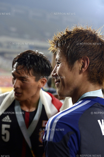 (R-L) Yoichiro Kakitani, Tomoaki Makino (JPN),<br /> JULY 28, 2013 - Football / Soccer :<br /> Yoichiro Kakitani of Japan smiles after winning the EAFF East Asian Cup 2013 match between South Korea 1-2 Japan at Jamsil Olympic Stadium in Seoul, South Korea. (Photo by FAR EAST PRESS/AFLO)