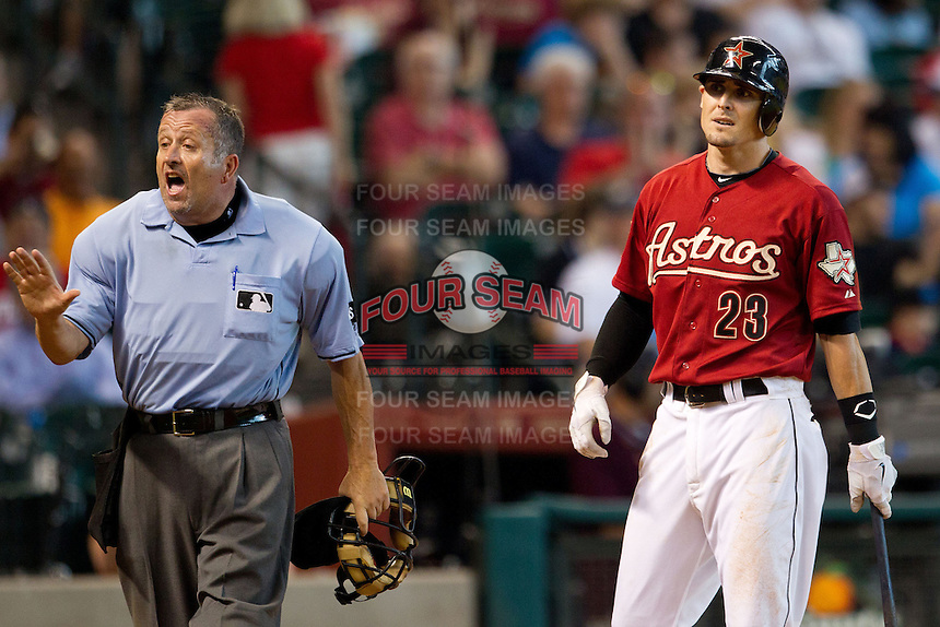 Houston Astros shortstop Tyler Greene #27 disagrees with umpire Dale Scott during the Major League baseball game against the Philadelphia Phillies on September 16th, 2012 at Minute Maid Park in Houston, Texas. The Astros defeated the Phillies 7-6. (Andrew Woolley/Four Seam Images)...