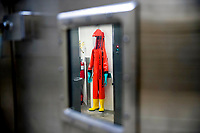 A biosafety protective suit for handling viral diseases are hung up in a biosafety level 4 training facility at U.S. Army Medical Research and Development Command at Fort Detrick in Frederick, Md., March 19, 2020, where scientists are working to help develop solutions to prevent, detect and treat the coronavirus. (AP Photo/Andrew Harnik)