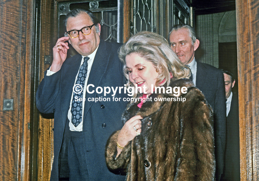 Reginald Maudling, Home Secretary, UK, on a visit to N Ireland, March 1971, leaves Parliament Buildings, Stormont, N Ireland, accompanied by his wife, Beryl Maudling, and Major James Chichester-Clark, prime minister, N Ireland. 197103000184<br />