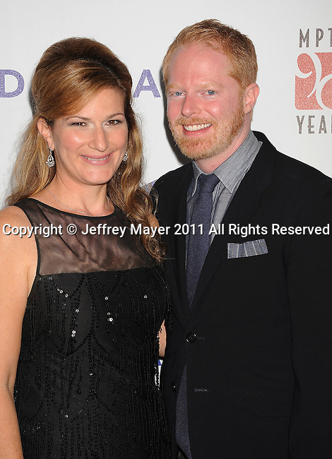 """CULVER CITY, CA - OCTOBER 15: Ana Gasteyer and Jesse Tyler Ferguson attend the The 6th Annual """"A Fine Romance"""" Event at Sony Pictures Studios on October 15, 2011 in Culver City, California."""
