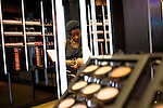 MAC Cosmetics employee Jamesha Brewer helps a customer select makeup at the store located in Concourse F at Hartsfield–Jackson Atlanta International Airport, in Atlanta, Georgia on August 28, 2013.