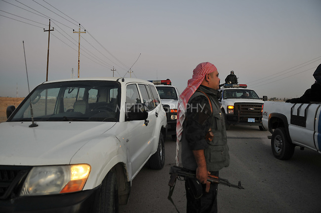 KIRKUK, IRAQ: An Iraqi policeman walks to his vehicle during an anti-terror raid..After receiving intelligence about a terrorist training camp in the Hamria mountains, the Kirkuk Regional Police conduct a dawn raid...This is the first anti-terror raid in Kirkuk after the withdrawal of US troops...Photo by Pazhar Mohammad/Metrography