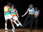 """13 October 2006: UNC's Quentin Thomas (l) and Surry Wood (2nd from left) dance with two members of the UNC Dance Team while entertaining the crowd. The University of North Carolina at Chapel Hill Tarheels held their first Men's and Women's basketball practices of the season as part of """"Late Night with Roy Williams"""" at the Dean E. Smith Center in Chapel Hill, North Carolina."""