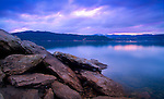 Idaho, North, Idaho Panhandle, Kootenai County, Coeur d'Alene. Slabs of rocks on Tubbs Hill with reflections in Lake Coeur d'Alene at sunset.