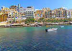 Waterfront hotel buildings beach and sea at Xlendi, island of Gozo, Malta