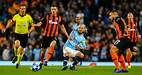 Manchester City's David Silva plays a through ball under pressure from Shakhtar Donetsk's Serhiy Kryvtsov<br /> <br /> Photographer Alex Dodd/CameraSport<br /> <br /> UEFA Champions League Group F - Manchester City v Shakhtar Donetsk - Wednesday 7th November 2018 - City of Manchester Stadium - Manchester<br />  <br /> World Copyright &copy; 2018 CameraSport. All rights reserved. 43 Linden Ave. Countesthorpe. Leicester. England. LE8 5PG - Tel: +44 (0) 116 277 4147 - admin@camerasport.com - www.camerasport.com