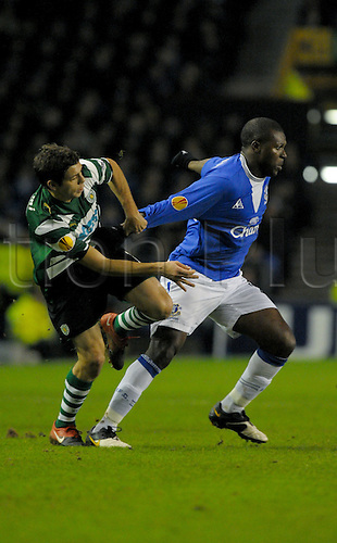 2010 Everton v Sporting Feb 16, Goodison Park. Yakubu holds off his man to win the ball in Sporting Lisbon half. Photo: Alan Edwards/Actionplus. - Editorial Use