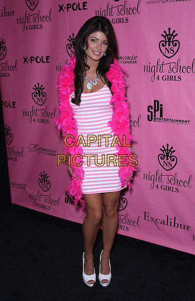 Laura Croft.Laura Croft's Night School 4 Girls celebrates its Grand Opening at The Excalibur Hotel and Casino, Las Vegas, Nevada, USA 7th October 2011..full length  sleeveless dress    hand on hip pink white striped feather boa.CAP/ADM/MJT.© MJT/AdMedia/Capital Pictures.
