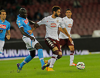 Kalidou Koulibaly  and  Marcelo Larrondo    in action during the Italian serie A   soccer match between SSC Napoli and Torino FC   at  the San Paolo   stadium in Naples  Italy , Octoberr 05 , 2014