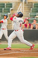 Larry Greene Jr. (14) of the Lakewood BlueClaws follows through on his swing against the Kannapolis Intimidators at CMC-Northeast Stadium on August 14, 2013 in Kannapolis, North Carolina.  The Intimidators defeated the BlueClaws 10-2.  (Brian Westerholt/Four Seam Images)