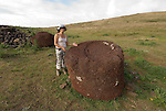 Chile, Easter Island: Platforms at site Ahu Vinapu showing two stages of stone construction, one more primitive and the latter more exquisite, possibly influenced by the Incas.  Red stone topknot at site..Photo #: ch317-33695..Photo copyright Lee Foster www.fostertravel.com lee@fostertravel.com 510-549-2202