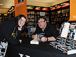 Sarah Mullen pictured with author Derek Landy at his book signing in Waterstones at Scotch Hall. Photo: Colin Bell/pressphotos.ie