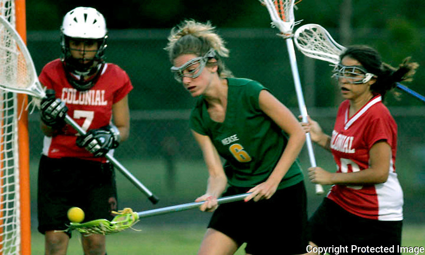 03/30/06....Gary Wilcox/The Times Union..... Nease High's  Lacrosse player  Jessica Wawrzyniak (cq)(#6)  moves the ball down the field during the Colonial High at Nease girls Lacrosse game this past Friday. (04/07/06).  Nease won 17 to 4.