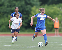 Boston Breakers defender Maddy Evans (18) passes the ball.  In a National Women's Soccer League Elite (NWSL) match, Sky Blue FC (white) defeated the Boston Breakers (blue), 3-2, at Dilboy Stadium on June 16, 2013.