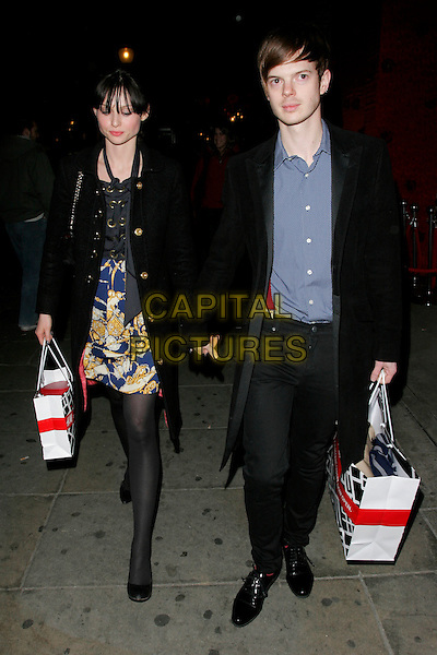 SOPHIE ELLIS BEXTOR & RICHARD JONES.The H&M Regent Street - launch party, H&M, Regent Street, London, England..February 13th, 2008.full length black coat jacket goody bag dress blue shirt married husband wife .CAP/AH.©Adam Houghton/Capital Pictures.