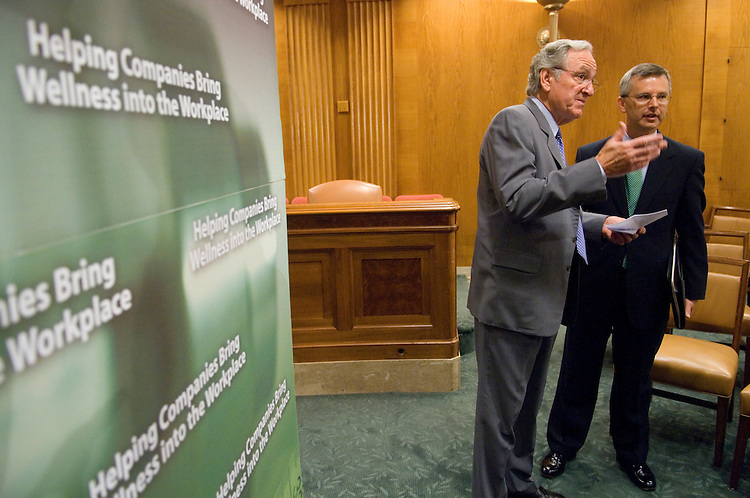 Sen. Tom Harkin, D-Iowa, left, speaks with John Clymer, president of Partnership for Prevention, before the start of the news conference to introduce the Healthy Work Act in the Dirkesen Senate Office Building on Monday, July 9, 2007. The legislation would provide for tax incentives to businesses that provide opportunities for their employees to lead healthier lives.