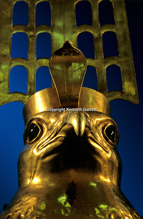 A golden plumed falcon head with obsidian eyes, Old Kingdom.