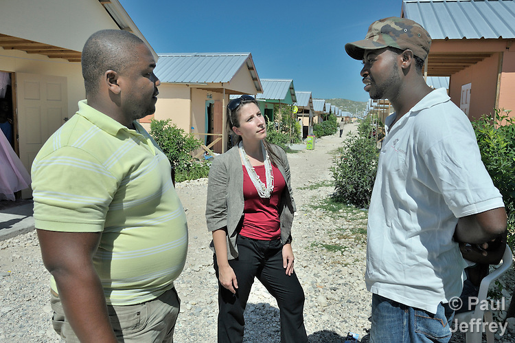 A staff member of the United Methodist Committee on Relief who asked not to be identified (center), discusses life in the Corail camp for resettled Haitian earthquake survivors with Edisson Laforest (left), a senior engineer for UMCOR, and Johnny Jean-Juste, a resident of the camp. UMCOR has built schools for the community, located north of quake-ravaged Port-au-Prince.