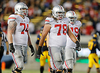 Ohio State Buckeyes offensive linesmen Jack Mewhort (74), Andrew Norwell (78) and Marcus Hall (79) approach the line of scrimmage during the NCAA football game against California at Memorial Stadium in Berkeley, California on Sept. 14, 2013. (Adam Cairns / The Columbus Dispatch)