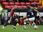 Samir Carruthers of Sheffield Utd glides past Harry Donovan of Millwall during the U23 Professional Development League Two match at Bramall Lane Stadium, Sheffield. Picture date 18th August 2017. Picture credit should read: Simon Bellis/Sportimage
