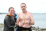Sue McKinney presents Ray Donagh with 2nd Prize at the Green Buoy 1KM Swim in Clogherhead....(Photo credit should read Jenny Matthews/NEWSFILE)...