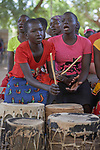 Girls sing and play drums during Catholic Mass in Gidel, a village in the Nuba Mountains of Sudan. The area is controlled by the Sudan People's Liberation Movement-North, and frequently attacked by the military of Sudan.
