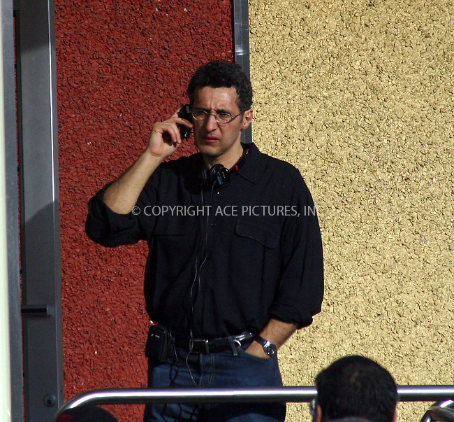 John Turturro directs his next movie 'Romance & Cigarettes' in Queens, New York. March 24, 2004. Please byline: BRIAN FLANNERY/ACE Pictures.   ..*PAY-PER-USE*      ....IMPORTANT: Please note that our old trade name, NEW YORK PHOTO PRESS (NYPP), is replaced by our new name, ACE PICTURES. New York Photo Press and ACE Pictures are owned by All Celebrity Entertainment, Inc.......All Celebrity Entertainment, Inc:  ..contact: Alecsey Boldeskul (646) 267-6913 ..Philip Vaughan (646) 769-0430..e-mail: info@nyphotopress.com