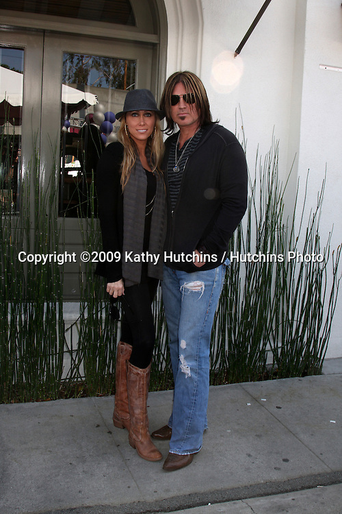 Tish & Billy Ray Cyrus arriving at the 7th Annual John Varvatos Stuart House Benefit at the John Varvatos Store in West Hollywood, CA  on.March 8, 2009.©2009 Kathy Hutchins / Hutchins Photo...                .