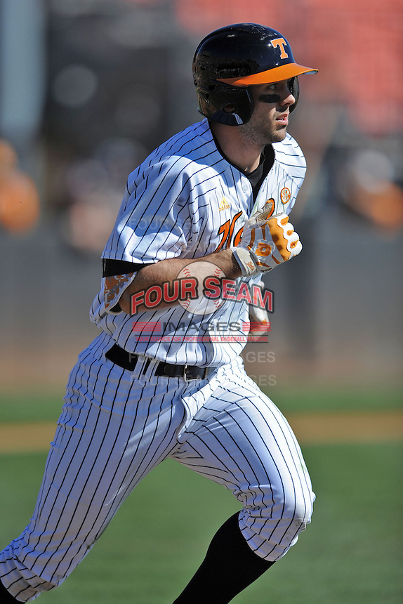 Right fielder Scott Price #5 of the Tennessee Volunteers runs to first during a game against the UNLV Runnin' Rebels at Lindsey Nelson Stadium on February 22, 2014 in Knoxville, Tennessee. The Volunteers defeated the Rebels 5-4. (Tony Farlow/Four Seam Images)
