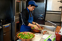 Aldo Sandoval (cq) prepares a spinach and strawberry salad at the Sigma Alpha Epsilon fraternity house on the Southern Methodist University campus in Dallas, Texas, Friday, january 20, 2011. Some high-end chefs have found professional salvation from an unlikely location: Fraternity Row. ..Matt Nager for The Wall Street Journal