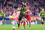Gelson Martins of Sporting CP (L) fights for the ball with Juan Francisco Torres Belen, Juanfran, of Atletico de Madrid (R) during the UEFA Europa League quarter final leg one match between Atletico Madrid and Sporting CP at Wanda Metropolitano on April 5, 2018 in Madrid, Spain. Photo by Diego Souto / Power Sport Images