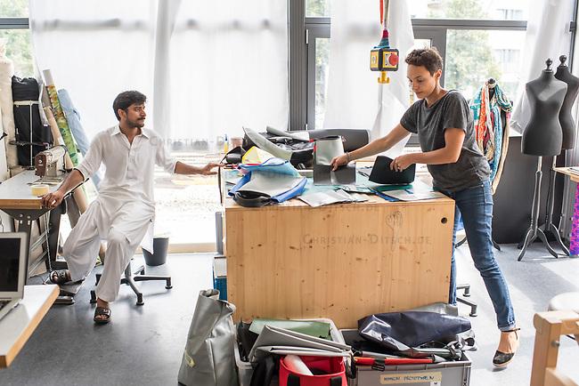 Das Berliner Start-up &quot;mimycri&quot; produziert Taschen aus den Gummiplanen gestrandeter Fluechtlingsboote.<br /> Statt Griechenlands Straende im Muell der gestrandeten Fluechtlingsboote ersticken zu lassen, stellt das Berliner Unternehmen &quot;mimycri&quot; daraus Taschen und Rucksaecke her und bietet Fluechtlingen eine Chance auf Normalitaet und Regelmaessigkeit.<br /> Im Bild vlnr.: Abid Ali, gefluechteter Schneider aus Pakistan und Nora Azzaoui, 30-Jaehrige Unternehmensberaterin aus Berlin.<br /> 8.8.2017, Berlin<br /> Copyright: Christian-Ditsch.de<br /> [Inhaltsveraendernde Manipulation des Fotos nur nach ausdruecklicher Genehmigung des Fotografen. Vereinbarungen ueber Abtretung von Persoenlichkeitsrechten/Model Release der abgebildeten Person/Personen liegen nicht vor. NO MODEL RELEASE! Nur fuer Redaktionelle Zwecke. Don't publish without copyright Christian-Ditsch.de, Veroeffentlichung nur mit Fotografennennung, sowie gegen Honorar, MwSt. und Beleg. Konto: I N G - D i B a, IBAN DE58500105175400192269, BIC INGDDEFFXXX, Kontakt: post@christian-ditsch.de<br /> Bei der Bearbeitung der Dateiinformationen darf die Urheberkennzeichnung in den EXIF- und  IPTC-Daten nicht entfernt werden, diese sind in digitalen Medien nach &sect;95c UrhG rechtlich geschuetzt. Der Urhebervermerk wird gemaess &sect;13 UrhG verlangt.]