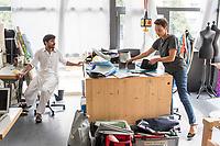 """Das Berliner Start-up """"mimycri"""" produziert Taschen aus den Gummiplanen gestrandeter Fluechtlingsboote.<br /> Statt Griechenlands Straende im Muell der gestrandeten Fluechtlingsboote ersticken zu lassen, stellt das Berliner Unternehmen """"mimycri"""" daraus Taschen und Rucksaecke her und bietet Fluechtlingen eine Chance auf Normalitaet und Regelmaessigkeit.<br /> Im Bild vlnr.: Abid Ali, gefluechteter Schneider aus Pakistan und Nora Azzaoui, 30-Jaehrige Unternehmensberaterin aus Berlin.<br /> 8.8.2017, Berlin<br /> Copyright: Christian-Ditsch.de<br /> [Inhaltsveraendernde Manipulation des Fotos nur nach ausdruecklicher Genehmigung des Fotografen. Vereinbarungen ueber Abtretung von Persoenlichkeitsrechten/Model Release der abgebildeten Person/Personen liegen nicht vor. NO MODEL RELEASE! Nur fuer Redaktionelle Zwecke. Don't publish without copyright Christian-Ditsch.de, Veroeffentlichung nur mit Fotografennennung, sowie gegen Honorar, MwSt. und Beleg. Konto: I N G - D i B a, IBAN DE58500105175400192269, BIC INGDDEFFXXX, Kontakt: post@christian-ditsch.de<br /> Bei der Bearbeitung der Dateiinformationen darf die Urheberkennzeichnung in den EXIF- und  IPTC-Daten nicht entfernt werden, diese sind in digitalen Medien nach §95c UrhG rechtlich geschuetzt. Der Urhebervermerk wird gemaess §13 UrhG verlangt.]"""
