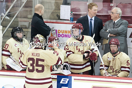 Ryan Polischuk (BC - 30), Parker Milner (BC - 35), John Hegarty (BC - Director, Hockey Operations), Patch Alber (BC - 3), Greg Brown (BC - Associate Head Coach), Jim Logue (BC - Assistant Coach), Michael Matheson (BC - 5) - The Boston College Eagles defeated the visiting University of Vermont Catamounts 4-2 (EN) in the first game of their best of three Hockey East quarterfinal matchup on Friday, March 15, 2013, at Kelley Rink in Conte Forum in Chestnut Hill, Massachusetts.