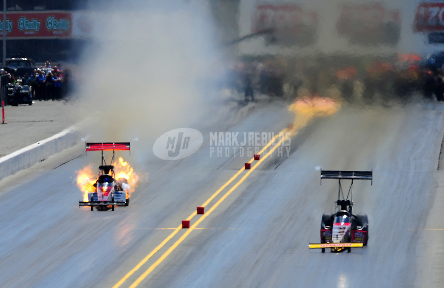 Jul. 30, 2011; Sonoma, CA, USA; NHRA top fuel dragster driver Steve Faria (left) explodes an engine on fire during qualifying for the Fram Autolite Nationals at Infineon Raceway. Mandatory Credit: Mark J. Rebilas-