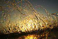 sunset reflecting off of splashing water