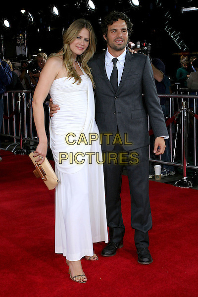 "SUNRISE COIGNEY & MARK RUFFALO.At the Los Angeles Premiere of ""Just Like Heaven"" held at Graumann's Chinese Theatre,.Los Angeles, 8th Septeber 2005.full length white shirt dress pinstripe wife husband couple beard mustache clutch bag purse.Ref: ADM/JW.www.capitalpictures.com.sales@capitalpictures.com.© Capital Pictures."