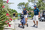 HOWEY IN THE HILLS, FL - MAY 11: Phoebe Nguyen of Whitman College gives a fist bump to coach Skip Molitor as they head over the bridge on the 18th hole.The Claremont Mudd Scripps won the team and individual (Margaret Loncki) First Place Championships during the Division III Women's Golf Championship held at the Mission Inn Resort & Club on May 11, 2018 in Howey-In-The-Hills, Florida. (Photo by Matt Marriott/NCAA Photos via Getty Images)