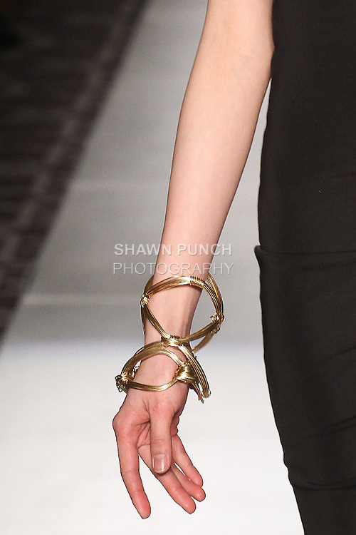 """Model walks runway wearing jewelry from the Ronnetta Coleman Fall Winter 2015 """"Lovely Bound"""" collection by Ronnetta J. Coleman, during the Accessories Premier Fall Winter 2015 fashion show for  Fashion Gallery New York Fashion Week Fall 2015."""