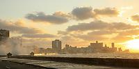 The sun sets along the Malecon in Havana, Cuba.
