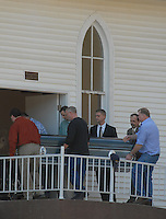 Pallbearers carry the casket of Sago miner Fred Ware into the Sago Baptist church near Buckhannon, WV, Monday, Jan. 9, 2005, for his wake.  Ware is one of the 12 miners killed in a mine explosion at the Sago mine near the church. (Gary Gardiner/EyePush Newsphotos)..<br />