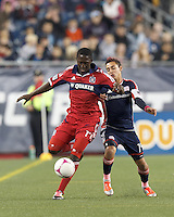 First half. Chicago Fire midfielder Patrick Nyarko (14) brings the ball forward as New England Revolution midfielder Diego Fagundez (14) closes. In a Major League Soccer (MLS) match, the New England Revolution defeated Chicago Fire, n-n, at Gillette Stadium on October 20, 2012.