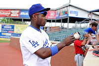 Chattanooga Lookouts outfielder Yasiel Puig #66 signs autographs after a game against the Birmingham Barons on April 17, 2013 at AT&T Field in Chattanooga, Tennessee.  Chattanooga defeated Birmingham 5-4.  (Mike Janes/Four Seam Images)