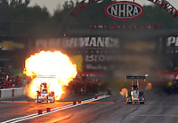 Sept. 1, 2014; Clermont, IN, USA; NHRA  top fuel dragster driver T.J. Zizzo explodes an engine on fire alongside Bob Vandergriff Jr during round one of the US Nationals at Lucas Oil Raceway. Mandatory Credit: Mark J. Rebilas-USA TODAY Sports