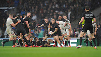 TJ Perenara of New Zealand passes during the QBE International match between England and New Zealand at Twickenham Stadium on Saturday 8th November 2014 (Photo by Rob Munro)