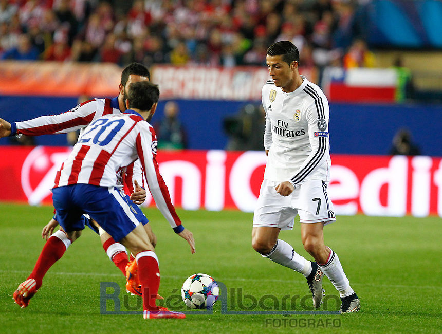 Real Madrid´s Portuguese forward Cristiano Ronaldo and Atletico Madrid´s Juanfran Torres