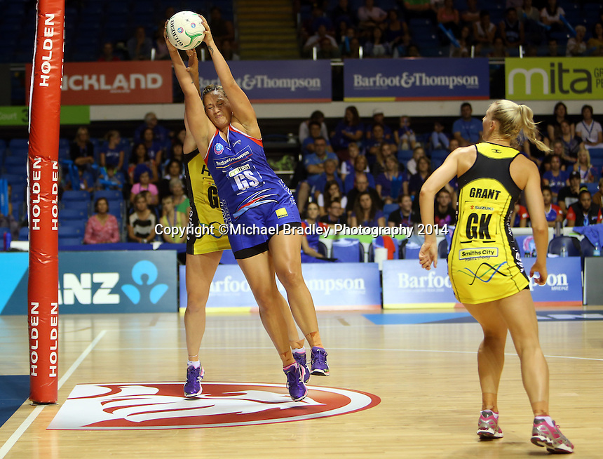 10.03.2014 Mystics Cathrine Latu and Pulse's Te Huinga Reo Selby-Rickit in action during the ANZ Champs match between the Northern Mystics and Hairer Pulse played at the Trusts Arena in Auckland. ©Michael Bradley.